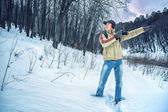 The photographer in the winter forest — Stock Photo