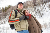 A young couple in the winter forest — Stock Photo