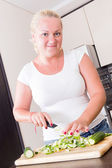 A stout woman in the kitchen — Stock Photo