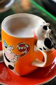 Milk cup — Stock Photo