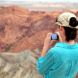 Woman at the Vulcano Crater - Stock Photo