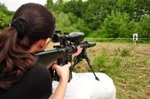Women with gun — Stock Photo