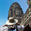 Man in bayon temple cambodia — Stock Photo