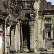 Stock Photo: Man in bayon temple cambodia