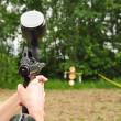 Stock Photo: Paintball gun in action