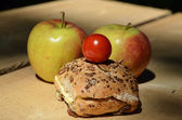 Apple and sandwich on table — Stock Photo