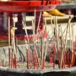 Red joss sticks burn in temple — Stock Photo