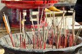 Red joss sticks burn in temple — Stock Photo