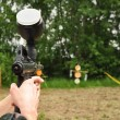 Paintball  player aiming with marker — Photo