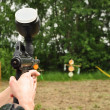 Paintball  player aiming with marker — Stockfoto