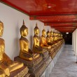 Wat Pho buddhas with red roof — Stock Photo