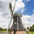 Historic Dutch polder mill - Stock Photo