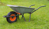 Wheelbarrow in the grass — Stock Photo