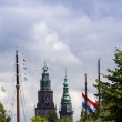 Dutch cityscape with church towers and boat masts — Stock Photo
