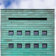 Square facade with copper strips - Stock Photo