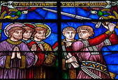 Stained glass with knight and saints — Stockfoto