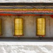 Buddhist prayer wheels at a temple — Stock Photo
