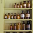 Old apothecary cabinet with storage jars - Stock Photo