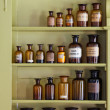 Old apothecary cabinet with storage jars - Stockfoto