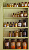 Old apothecary cabinet with storage jars — Photo