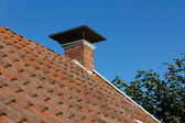 Roof and chimney on old house — Stock Photo