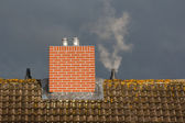 Roof and chimney against the background of bad weather — Stock Photo