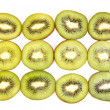Half kiwi fruit on a row — Stock Photo