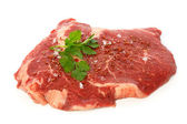 Raw matured rib eye with spices and coriander — Stock Photo