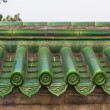 Green glazed roof tiles on wall — Stock Photo #19938969