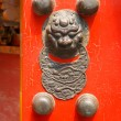 Chinese red door with a dragon head - Stock Photo