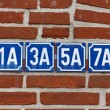 House numbers on wall — Stock Photo #21382935