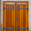 Wooden doors with decorative fittings - Stockfoto