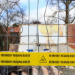Yellow tape with Dutch text 'no trespassing asbestos' - Stock Photo