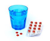Medicine and a glass of water — Stock Photo