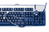 Blue computer keyboard with stethoscope — Stock Photo