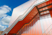 Orange stairs on the outside of modern building — Stock Photo