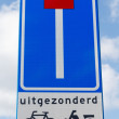 Road sign indicating dead end except for cyclists and mopeds - Stock Photo