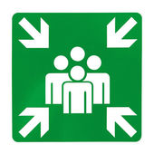 Green assembly point sign — Stock Photo