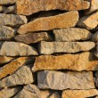 Wall made of natural stone in the evening sun — Stockfoto