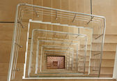 Indoor stairway in square spiral — Stock Photo