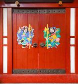 Door gods on red doors in China — Stock Photo