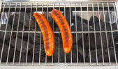 Grilled sausages on the barbecue — Stock Photo