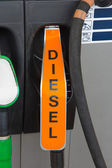 Diesel fuel nozzle at gas station — Stock Photo