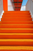 Detail of orange steel stairway — Stock Photo