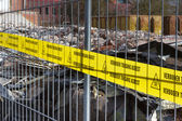 Yellow no Trespassing tape for asbestos in dutch — Stock Photo