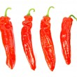 Four pointed peppers in row — Stock Photo #39869179