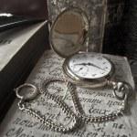 Golden pocket watch - sepia style — Stock Photo #12549811