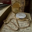 Golden pocket watch — Stock Photo #12549764