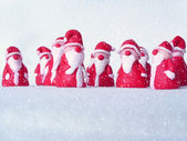 A group of santas in the snow — Stock Photo