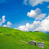 Wooden huts in the mountains — Stock Photo